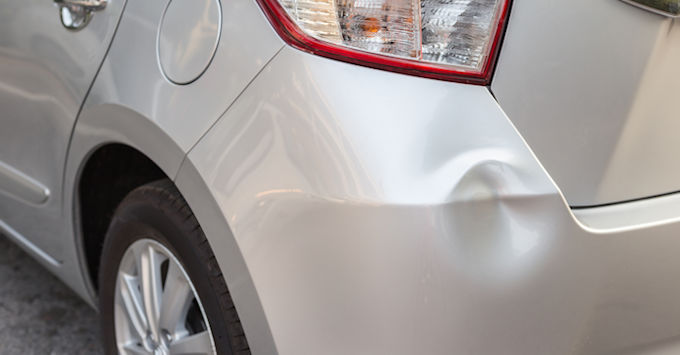 Small dent in the rear fender of a car